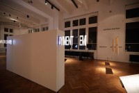 Exhibition view 'out of the box. 10 Questions about Artistic Research' w/ Ruth Schnell's light installation 'Floating Signs 2' Photo: kainz