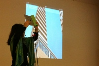 Tamiko Thiel demonstrating how 'Fractured Visions' work.
